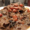 Slow Cooked Big Head With Chinese Smoked Sausage And Red Wine Broth